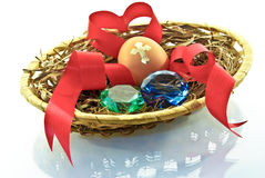 Egg, heart,emeralds, love is in the basket of isolated on a white background Stock Photo