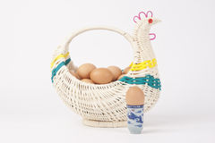 The egg in hen basket. On white background Royalty Free Stock Image