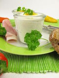 Egg on herb cream cheeses in the glass Stock Images