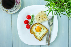 Egg-in-a-hole breakfast dish Stock Images