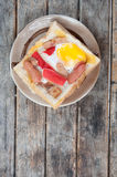Egg, hotdog and crab stick in a hole Stock Images