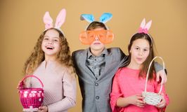 Egg hunt. Family and sisterhood. Spring holiday party. Little girls and boy with busket. Happy easter. Children in. Rabbit bunny ears. easter hunt. Collecting royalty free stock images