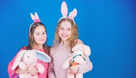 Egg hunt. Family and sisterhood. Spring holiday party. Little girls with hare toy. Happy easter. Children in rabbit. Bunny ears. copy space. little girls with stock photography