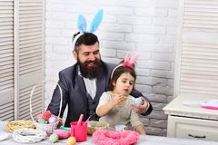 Egg hunt on spring holiday. father and daughter paint easter eggs. Family love easter. Happy easter. Childhood. Rabbit. Family with bunny ears. Easter menu stock images