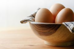 Egg inside wooden white background Royalty Free Stock Image