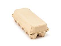 Egg la caja de moldeo de papel de empaquetado aislada en el fondo blanco Imagen de archivo