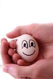 Egg la mano Imagenes de archivo