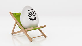 Egg with lay down on summer beach chair  on white,abstract background for Easter holiday concept. Stock Photos