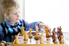 Boy playing chess. A small boy playing chess Royalty Free Stock Image