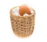 Egg with little bit crack in handicraft basket. Royalty Free Stock Image