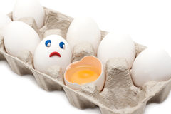 Egg looks at broken person Royalty Free Stock Photography