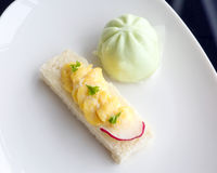 Egg mayo bread tartine and dumpling. With parsley and radish on white plate Royalty Free Stock Images