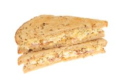 Egg mayonnaise and bacon sandwich. Es made with lightly toasted granary bread, isolated against white Stock Photo