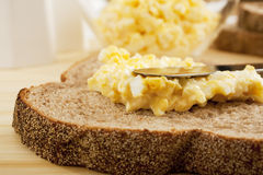 Egg Mayonnaise being Spread on Bread Royalty Free Stock Photos