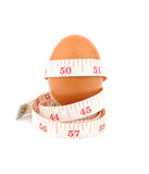 Egg and measurement tape isolated on white background royalty free stock photo