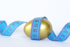 Egg with measuring tape Stock Images