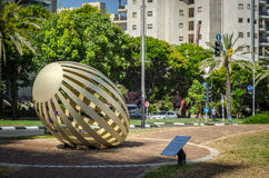Egg metal sculpture in small park. Holon, Israel-July 21, 2016:  Bent painted metal art sculpture Egg by Yael Artsi is located at small city park at Golda Meir Royalty Free Stock Photo