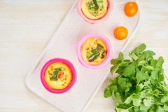 Egg muffins, paleo, keto diet. Omelet with spinach, vegetables, tomatoes baked in small molds.  stock images
