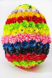 Egg with multicolored flowers on white background stock photos