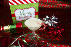 Egg Nog with Wrapping Paper Stock Image