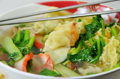 Egg noodle with barbecue pork and wanton in the soup Stock Photography
