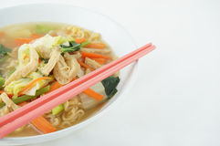 Egg noodle and clear soup vegetarian with chopsticks. Egg noodle and clear soup vegetarian for health. It include vegan protein dry, carrot, kale and cabbage on Royalty Free Stock Photos