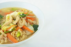 Egg noodle and clear soup vegetarian. For health. It include vegan protein dry, carrot, kale and cabbage on white background Royalty Free Stock Images