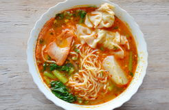 Egg noodle with pork dumpling in spicy soup on bowl Royalty Free Stock Photo