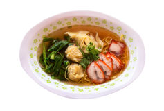 Egg noodle soup with red roast pork on white background Stock Images