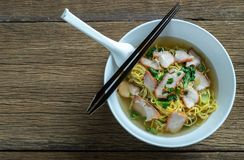 Red pork noodles ,bowl of noodles with vegetables royalty free stock photo