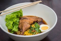 Egg noodle with steamed duck and boiled egg in soup Royalty Free Stock Images