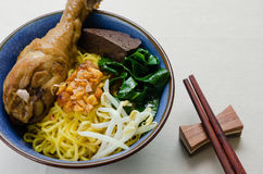 Egg Noodle with Stewed Chicken. Egg noodle with herb stewed chicken is the famous Chinese food its easy to enjoy eating Royalty Free Stock Image