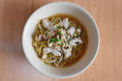 Egg noodle topping with boiled pork in soup Royalty Free Stock Photos