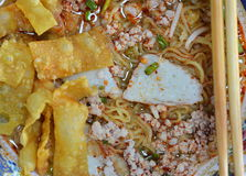 Egg noodle topping fish line and deep fried dumpling strip. In bowl Royalty Free Stock Photo