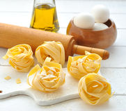 Egg noodles, eggs and olive oil Royalty Free Stock Images