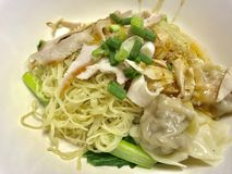 egg noodle , red pork with dumpling Stock Photos