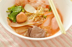 Egg noodles with shrimp and fish ball in red soup Chinese-language called Yong Tau Fu Royalty Free Stock Photos