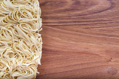 Egg noodles spiral closeup Royalty Free Stock Photo