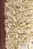 Egg noodles spiral closeup Stock Image