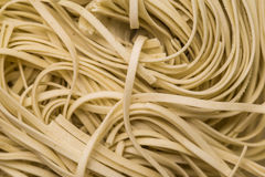 Egg noodles wooden background Royalty Free Stock Images