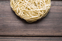 Egg noodles wooden background Royalty Free Stock Photography