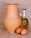 Egg, oil and pitcher Stock Photos