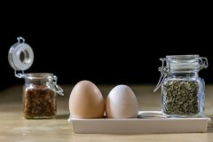 Egg, olive oil, spices on the kitchen table. Wooden table, kitch Royalty Free Stock Photos
