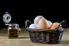 Egg, olive oil, spices on the kitchen table. Wooden table, kitch Stock Images