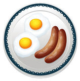 An egg omelet and sausages Stock Photo