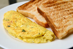 Egg omelet with toast. Egg omelet with white toast royalty free stock image