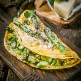 Egg Omelette Garnished with Asparagus and Cheese Royalty Free Stock Photography