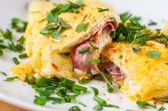 Egg omelette with ham and cheese with chive. Egg omelette with ham and cheese with chive, closeup royalty free stock photography