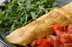 Egg omelette with salad. Perfect eggs omelette with vegetable salad, fresh arugula and juice royalty free stock photos