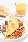 Egg omelette with vegetables and ham Royalty Free Stock Image